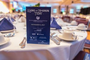 Citation Award Program standing up on clothed dinner table in a banquet room.