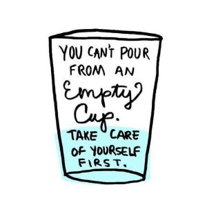 """A white cup with black text with light blue at the bottom stating, """"You can't pour from an empty cup. Take care of yourself first."""""""