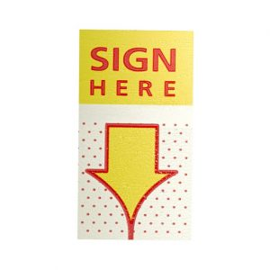 """Yellow sticker and arrow down with red text that says """"Sign Here."""""""